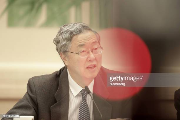 Zhou Xiaochuan, governor of the People's Bank of China , speaks at a news conference at the Great Hall of the People during the 19th National...