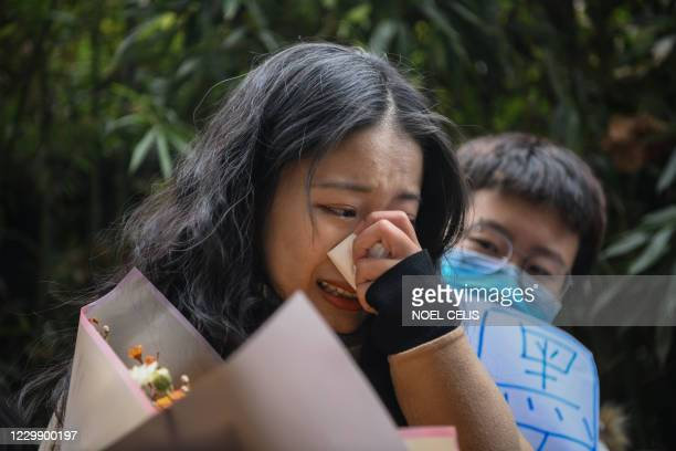 Zhou Xiaoxuan, a feminist figure who rose to prominence during Chinas #MeToo movement two years ago, reacts amongst her supporters as she arrives at...