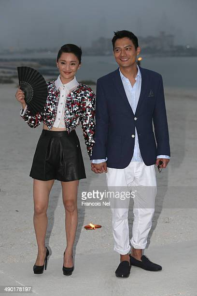 Zhou Xun and Archie David Kao attends the Chanel Cruise Collection 2014/2015 Photocall at The Island on May 13 2014 in Dubai United Arab Emirates