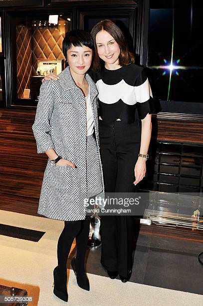 Zhou Xun and Elsa Zylberstein visit the IWC booth during the launch of the Pilot's Watches Novelties from the Swiss luxury watch manufacturer IWC...