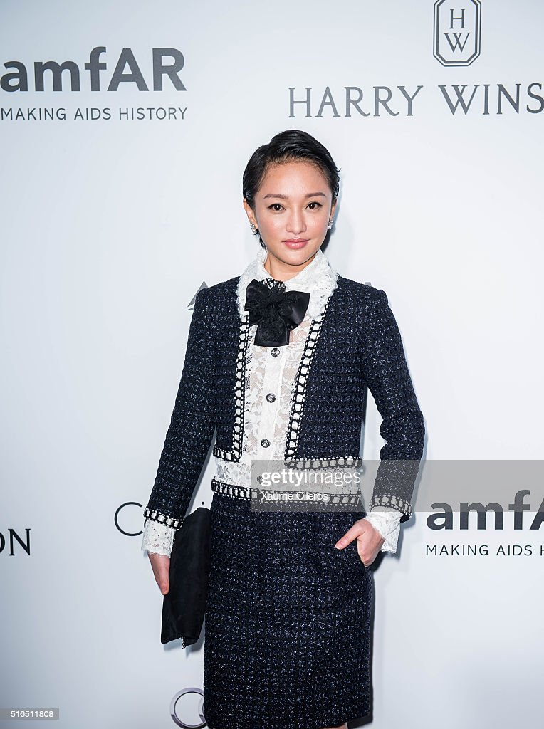 Zhou Xun attends the 2016 amfAR Hong Kong gala with a guest at Shaw Studios on March 19, 2016 in Hong Kong, Hong Kong.