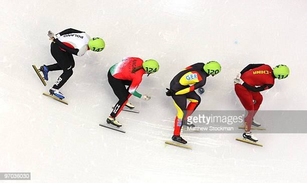 Zhou Yang of China leads Aika Klein of Germany Erika Huszar of Hungary and Paula Bzura of Poland in the Short Track Speed Skating Ladies 1000m heat...
