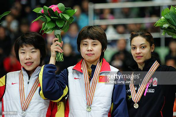 Zhou Yang of China, Wang Meng of China and Kalyna Roberge of Canada pose on the podium after the medals ceremony of the Ladies 1000M final of the...