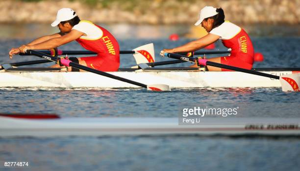Zhou Yangjing and Shan Zilong of China who win the Gold complete in the Rowing Mixed Double Sculls TA Final at Shunyi Olympic RowingCanoeing Park...