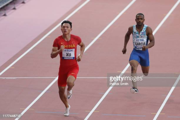 Zhouzheng Xu of China competes in the Men's 100 metres preliminary round during day one of 17th IAAF World Athletics Championships Doha 2019 at...