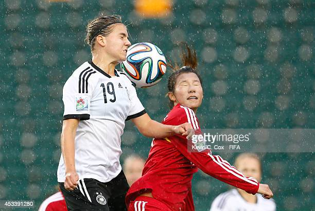Zhu Beiyan of China PR battles for a header against Rieke Dieckmann of Germany at Commonwealth Stadium on August 8 2014 in Edmonton Canada