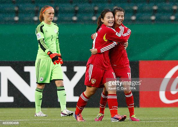 Zhu Beiyan of China PR celebrates her goal against goalkeeper Meike Kaemper of Germany with Xiao Yuyi during the FIFA U20 Women's World Cup Canada...