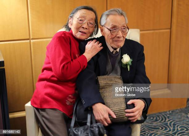 Zhu Dayun and Hui Zong who have been married for 61 years share a chair during the annual Boston Elderly Commission Golden Wedding Anniversary...