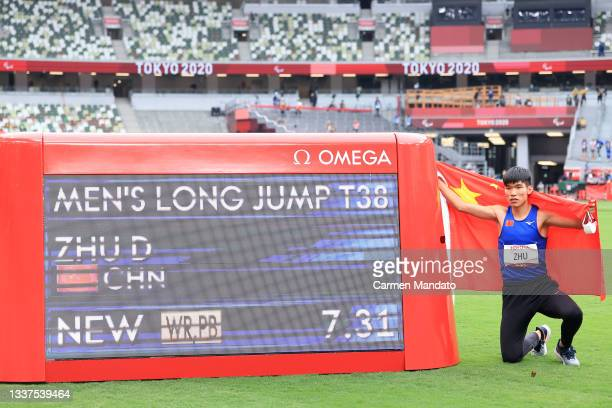 Zhu Dening of Team China celebrates winning the gold medal with new world record in the Men's Long Jump T-38 on day 8 of the Tokyo 2020 Paralympic...