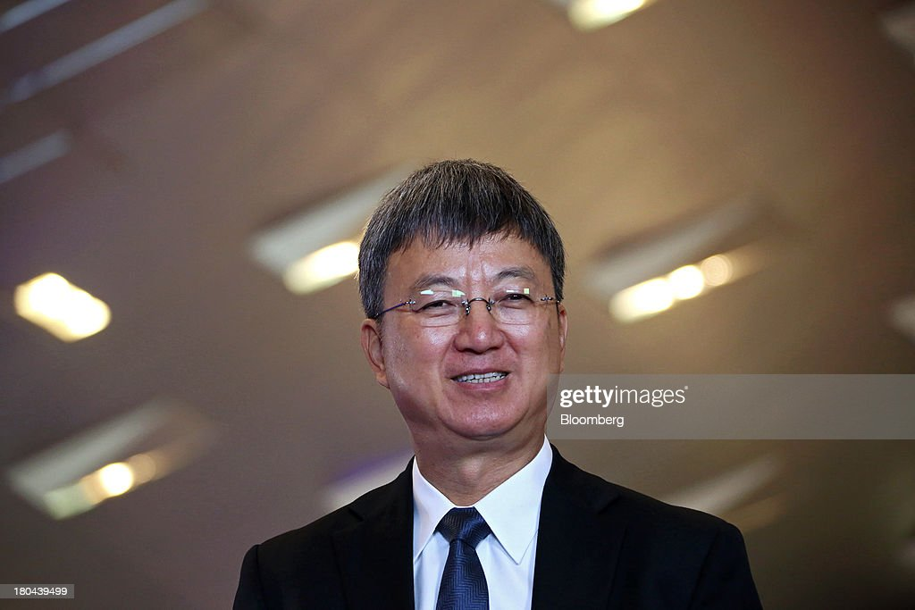 Zhu Min, deputy managing director at the International Monetary Fund (IMF), speaks during an interview at the World Economic Forum Annual Meeting Of The New Champions in Dalian, China, on Friday, Sept. 13, 2013. China's economic slowdown is a good thing for the nation and the world as too-strong growth creates overheating, overcapacity and over-investment, Zhu said. Photographer: Tomohiro Ohsumi/Bloomberg via Getty Images