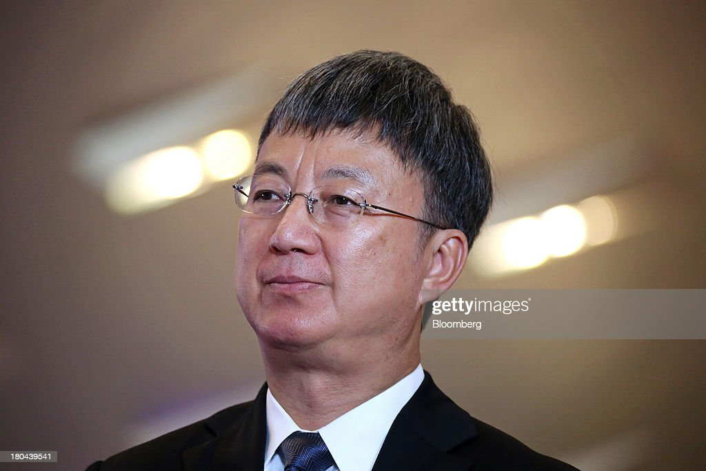 Zhu Min, deputy managing director at the International Monetary Fund (IMF), listens during an interview at the World Economic Forum Annual Meeting Of The New Champions in Dalian, China, on Friday, Sept. 13, 2013. China's economic slowdown is a good thing for the nation and the world as too-strong growth creates overheating, overcapacity and over-investment, Zhu said. Photographer: Tomohiro Ohsumi/Bloomberg via Getty Images