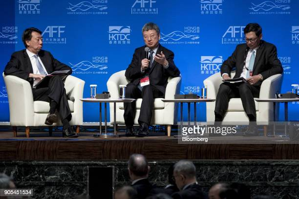 Zhu Min president of National Institute of Finance Research at Tsinghua University center speaks as Ben Hung chief executive officer of Retail...