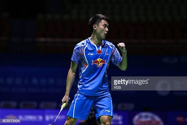 Zhu Siyuan of China celebrates a point against Khosit Phetpradab of Thailand in the men's singles qualifying round of Thaih China Open 2016 at Fuzhou...