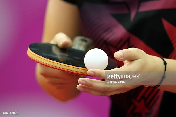 Zhu Ying of China prepares to serve to Feng Tianwei of Singapore during the Table Tennis Women's Semi Final during the day fifteen of the 2014 Asian...