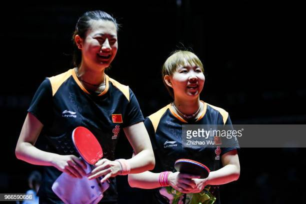 Zhu Yuling and Zhu Yuling of China celebrate at the women's doubles final compete with Jeon Jihee and Yang Haeun of South Korea during the 2018 ITTF...