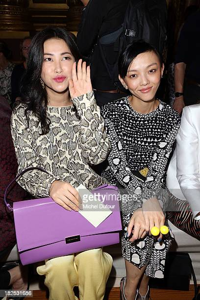 Zhu Zhu and Rila Fukushima attend the Stella McCartney show as part of the Paris Fashion Week Womenswear Spring/Summer 2014 on September 30 2013 in...
