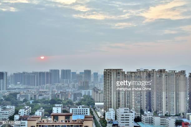 zhuhai city skyline at sunset, china - zhongshan stock-fotos und bilder