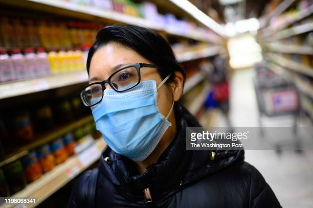 Zhuying Hua of Rockville is concerned about coronavirus and wears a mask while shopping Many shoppers at the Great Wall Supermarket in Rockville...