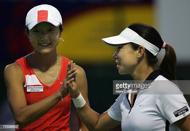 Zi Yan and Jie Zheng of China celebrate their win over Alina Jidkova of Russia and Tatiana Perebeynis of the Ukraine during day five of the Moorilla...