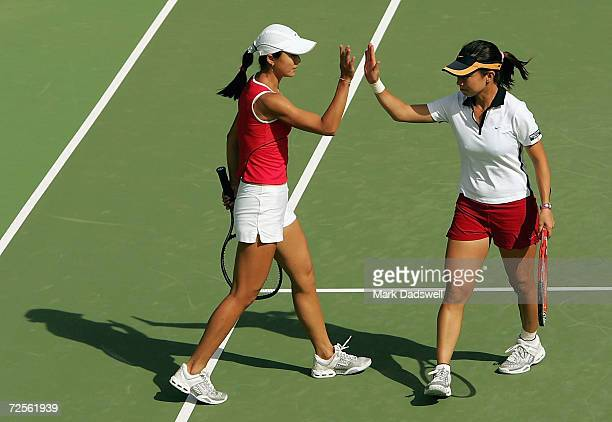 Zi Yan and Jie Zheng of China celebrate their win over Casey Dellacqua and Nicole Sewell of Australia during day four of the Moorilla International...