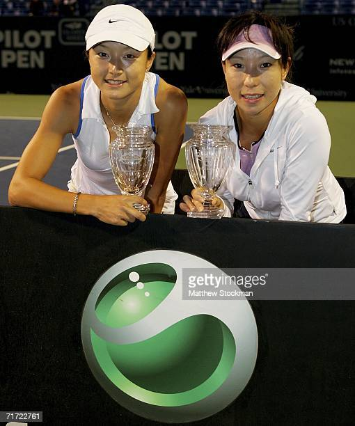 Zi Yan and Jie Zheng of China pose for photographers after defeating Lisa Raymond and Samantha Stosur of Australia during the doubles final of the...