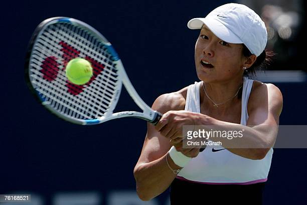 Zi Yan of China returns a shot against Justine Henin of Belgium during the Rogers Cup at the Rexall Center August 18 2007 in Toronto Ontario Canada