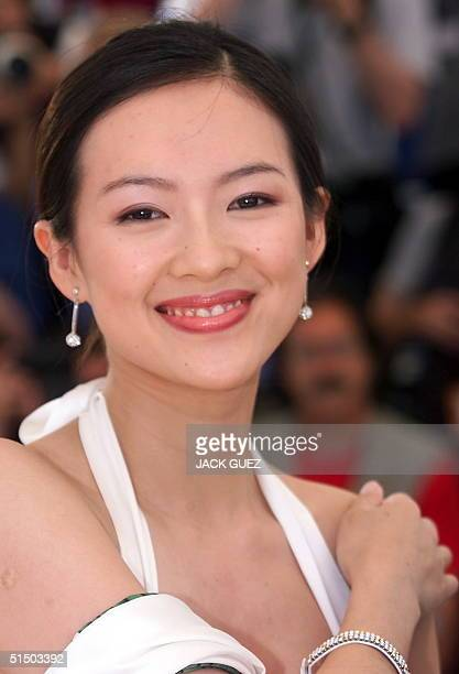 Zi Yi Zhang poses during the photocall of Taiwanese director Ang Lee movie Crouching Tiger Hidden Dragon 19 May 2000 in Cannes The film is presented...
