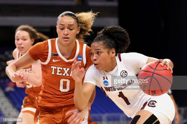 Zia Cooke of the South Carolina Gamecocks drives to the basket against Celeste Taylor of the Texas Longhorns during the first half in the Elite Eight...