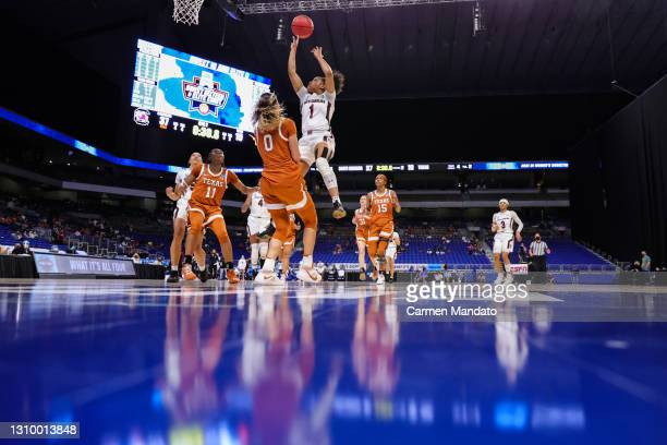 Zia Cooke of the South Carolina Gamecocks drives to the net over Celeste Taylor of the Texas Longhorns during the first half in the Elite Eight round...