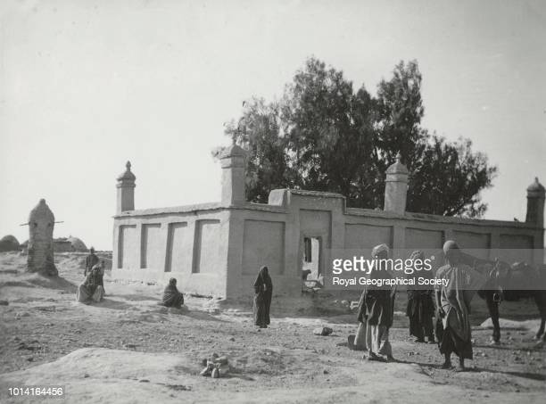 Ziarat Bibi Dast where those who have been bitten by mad dogs go only women can go in men rub their bodies all along the outside wall Afghanistan 1903