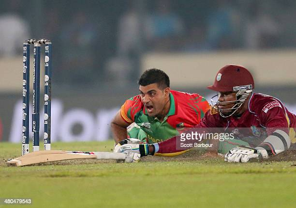 Ziaur Rahman of Bangladesh reacts after missing the stumps as he attempts to run out Marlon Samuels of the West Indies during the ICC World Twenty20...