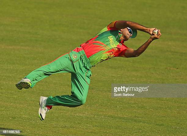 Ziaur Rahman of Bangladesh takes a diving catch to dismiss Kamran Akmal of Pakistan during the ICC World Twenty20 Bangladesh 2014 match between...