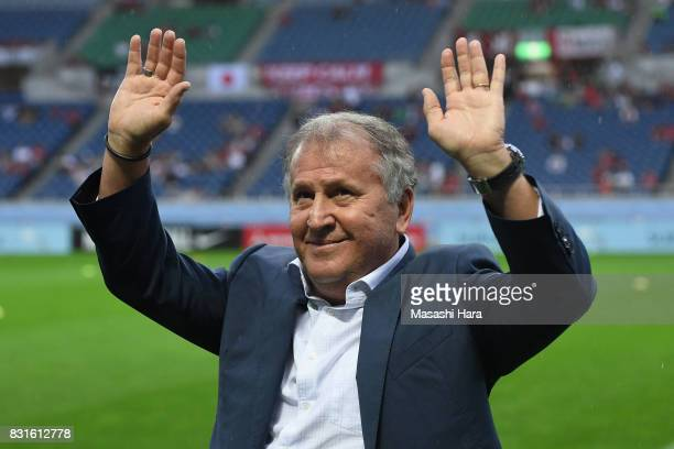 Zico waves to supporters during the Japan Football Hall of Fame Award Ceremony prior to the Suruga Bank Championship match between Urawa Red Diamonds...