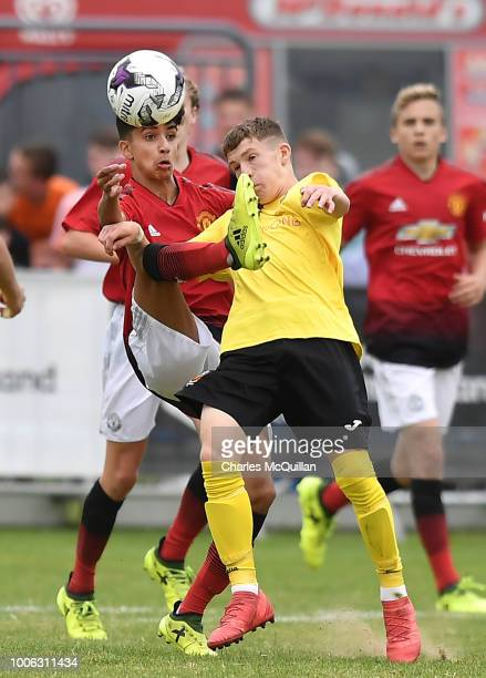 Zidane Iqbal of Manchester United and Charlie Allen of County Antrim during the SuperCupNI Junior section final at Ballymena Showgrounds on July 27...