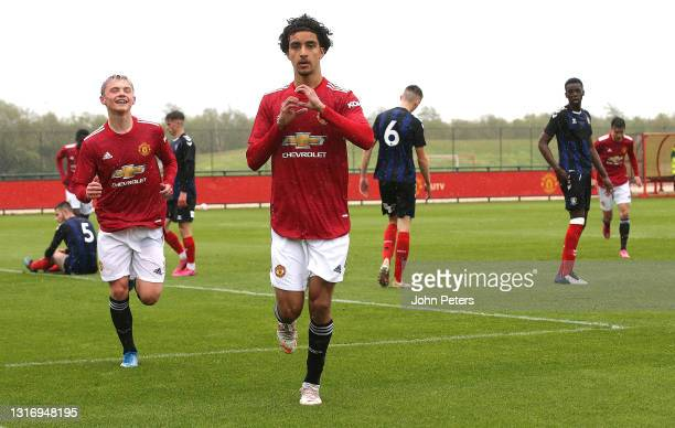 Zidane Iqbal of Manchester United U18s celebrates scoring their first goal during the U18 Premier League match between Manchester United U18s and...