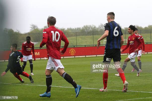 Zidane Iqbal of Manchester United U18s scores their first goal during the U18 Premier League match between Manchester United U18s and Middlesbrough...