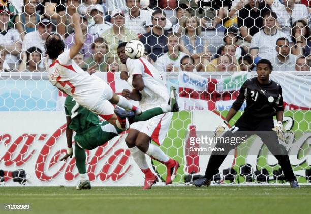 Zied Jaziri of Tunisia scores the opening goal during the FIFA World Cup Germany 2006 Group H match between Tunisia and Saudi Arabia at the Stadium...