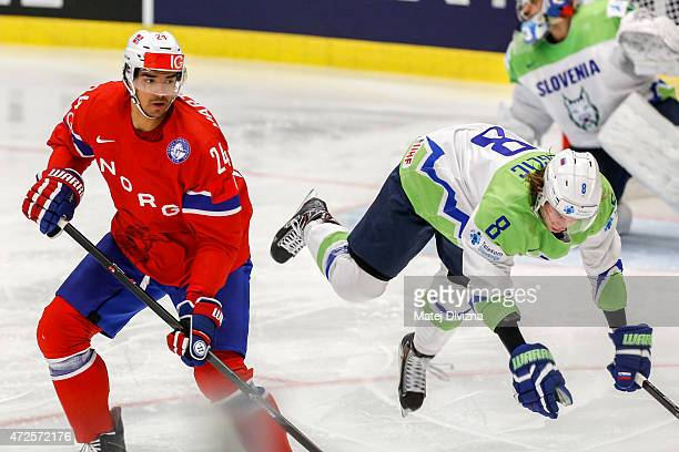 Ziga Jeglic of Slovenia and Andreas Martinsen of Norway battle for the puck during the IIHF World Championship group B match between Slovenia and...