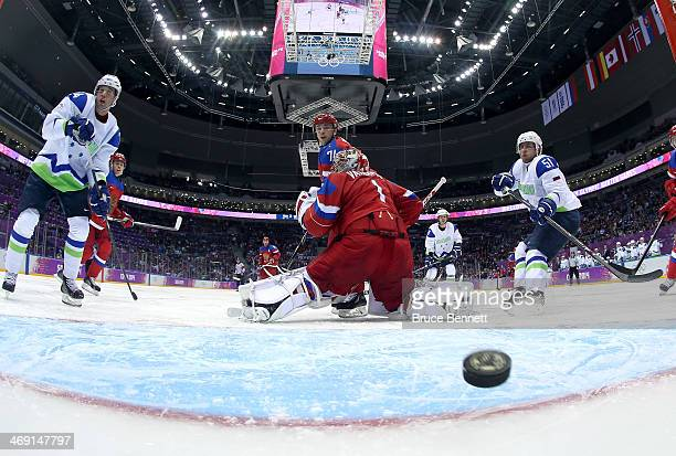 Ziga Jeglic of Slovenia scores a goal in the second period against Semyon Varlamov of Russia during the Men's Ice Hockey Preliminary Round Group A...