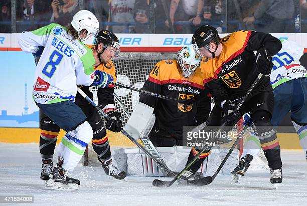 Ziga Jeglic of Team Slovenia Moritz Mueller Dennis Endras and Justin Krueger of Team Germany during the game between Germany and Slovenia on april 29...