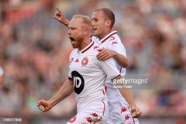 Ziggy Gordon of the Wanderers celebrates his goal with team mates during the A-League match between the Newcastle Jets and the Western Sydney...