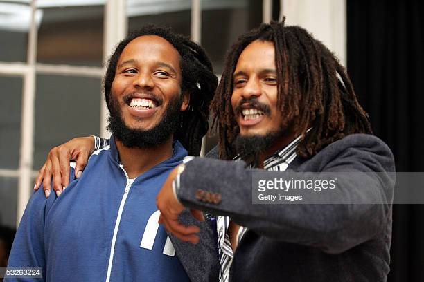Ziggy Marley and Rohan Marley both sons of Bob Marley hang out backstage at the Tuff Gong Clothing line launch party on July 19 2005 in New York City...