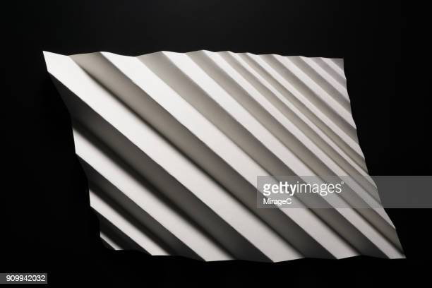 zigzag paper - folded stock photos and pictures