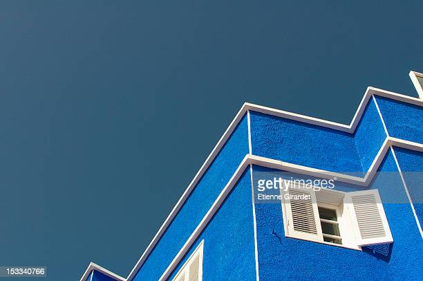 Zigzag pattern of outline of house against clear sky