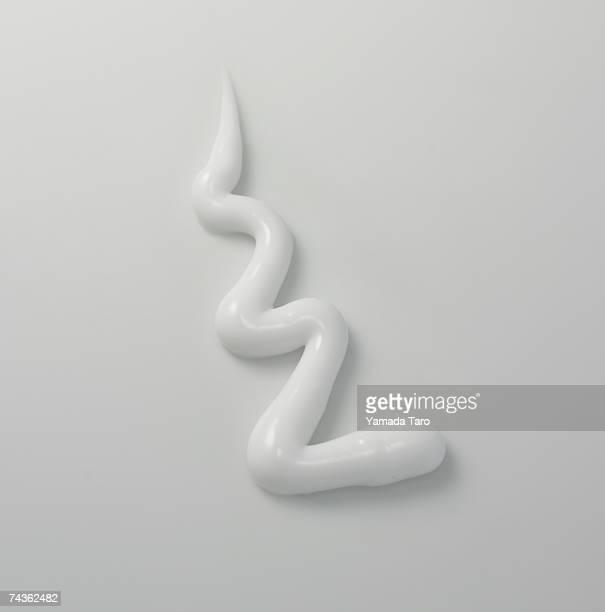 Zigzag shape of white cream, close-up