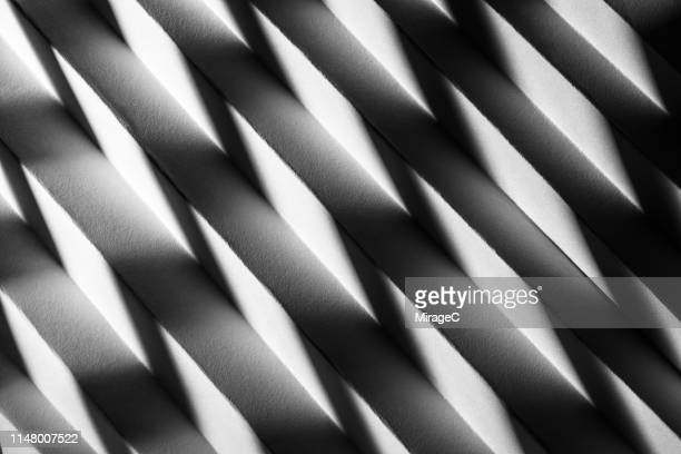 zigzag shaped light and shadow on paper - high contrast stock pictures, royalty-free photos & images