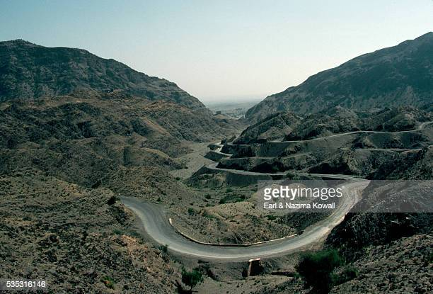 zigzagging road at khyber pass - khyber pass stock pictures, royalty-free photos & images