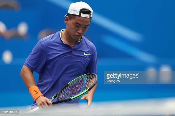 Zihao Xia of China reacts during the match against Mate Pavic of Croatia during Qualifying second round of 2017 ATP Chengdu Open at Sichuan...