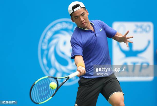 Zihao Xia of China returns a shot during the match against Mate Pavic of Croatia during Qualifying second round of 2017 ATP Chengdu Open at Sichuan...