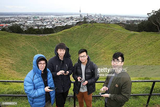 Zijia Ge Jack Zheng Ky Pham and Tony Sun search for Pokemon on the top of Mount Eden on July 13 2016 in Auckland New Zealand The augmented reality...